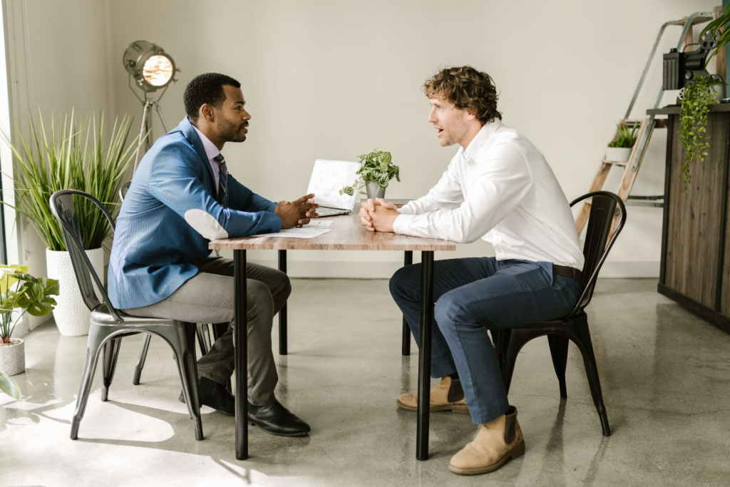 A man sitting and discussing about insurance policies with an insurance provider